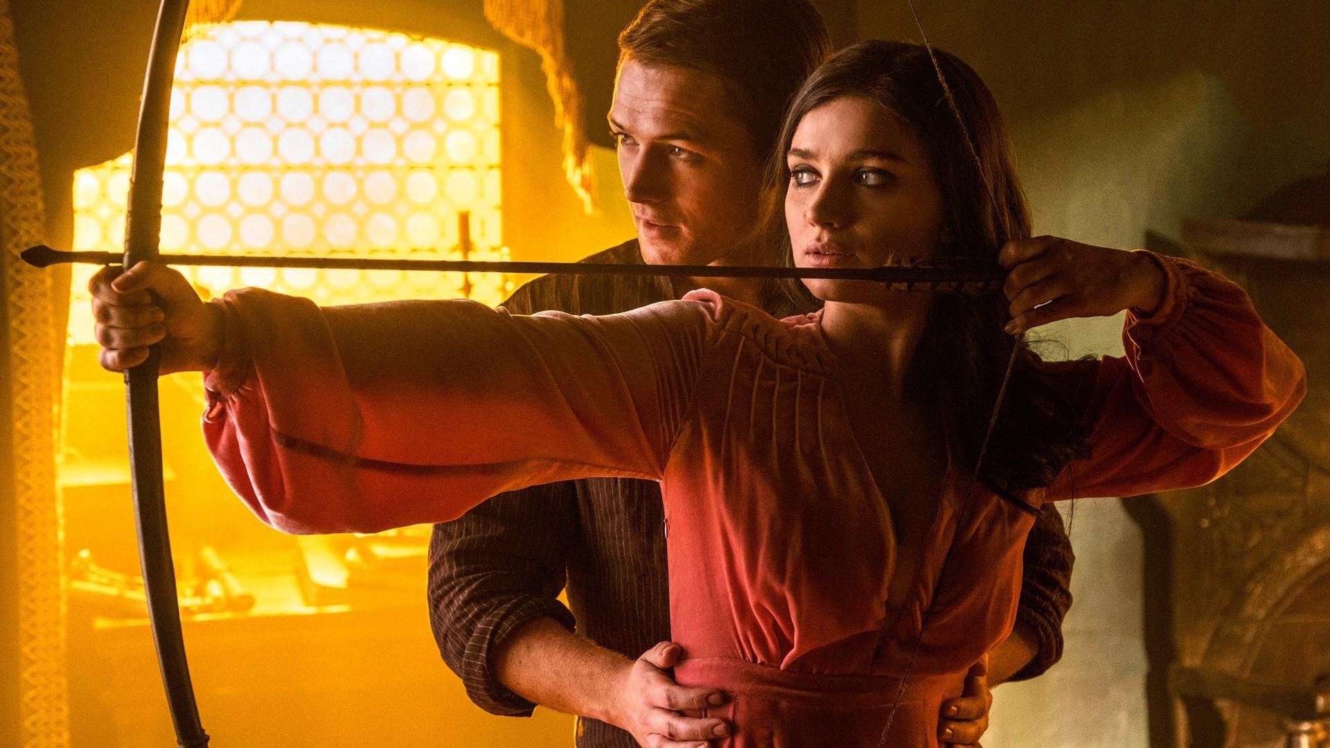 Eve-Hewson-Taron-Egerton-in-Robin-Hood-2018