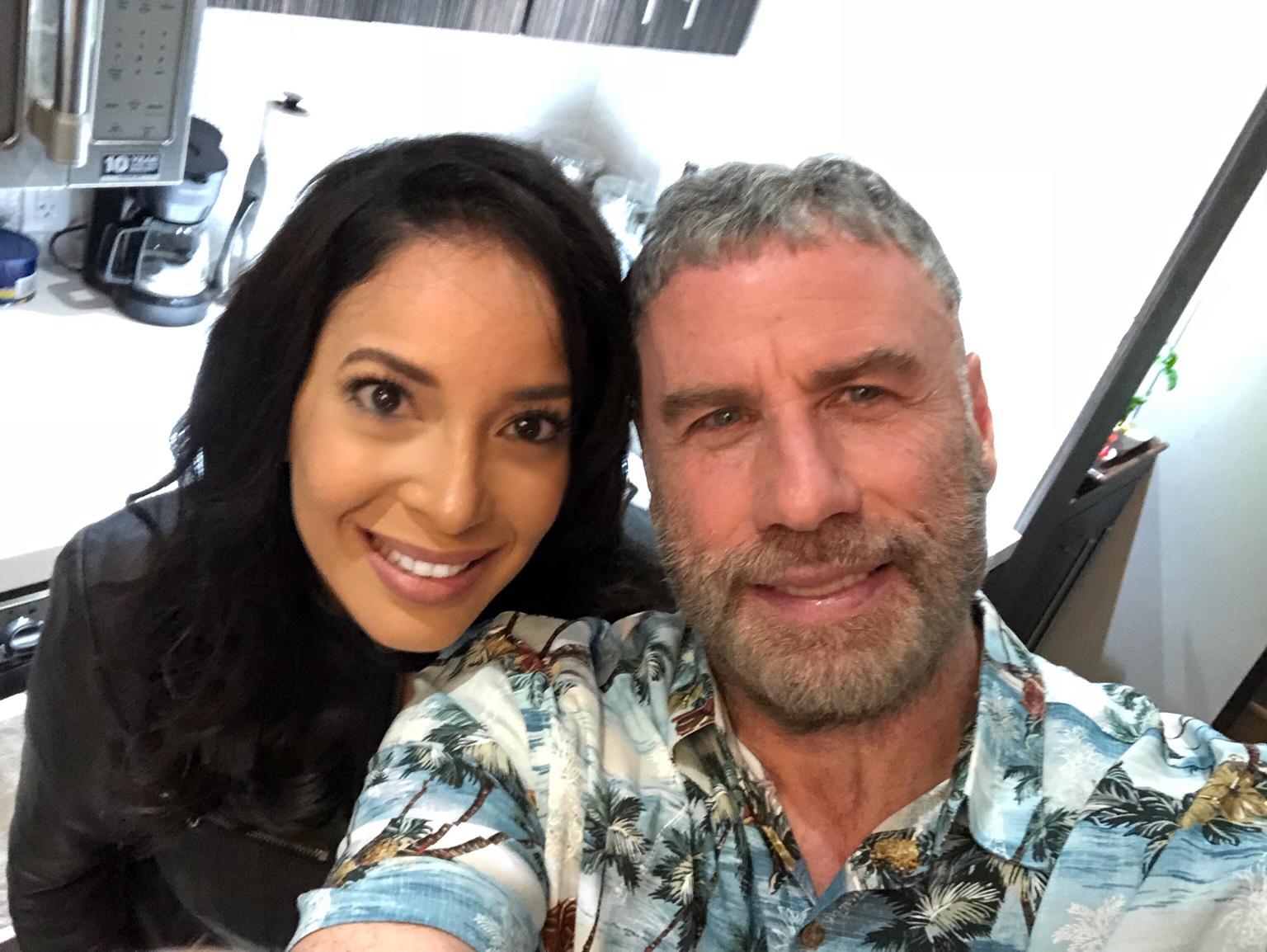 Marta González y John Travolta